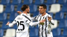 Juventus midfielder Adrien Rabiot celebrates with Cristiano Ronaldo