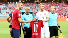 Simon Kjaer and Denmark are presented with a Czech Republic jersey donning Christian Eriksen's name during Euro 2020