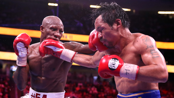 Yordenis Ugas (L) connects with a punch on Manny Pacquiao during their WBA welterweight title fight at T-Mobile Arena on August 21, 2021 in Las Vegas, Nevada. Ugas retained his title by unanimous decision