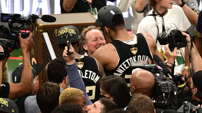 Giannis Antetokounmpo embraces Mike Budenholzer