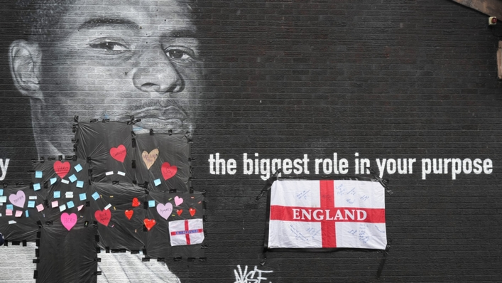 A defaced mural of Marcus Rashford was covered in messages of support