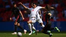 England midfielder Jude Bellingham is challenged by Luka Modric