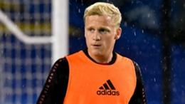 Manchester United's Donny van de Beek warms up