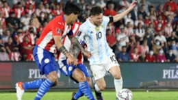 Lionel Messi (R) in action against Paraguay