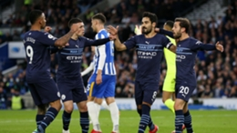 Manchester City's players celebrate their opening goal against Brighton