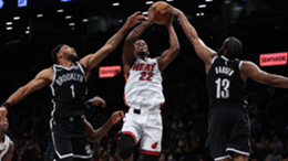 Jimmy Butler #22 of the Miami Heat shoots against Bruce Brown #1 of the Brooklyn Nets and James Harden #13 of the Brooklyn Nets