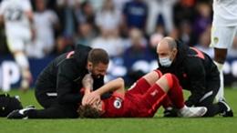 Liverpool's Harvey Elliott is treated after his injury