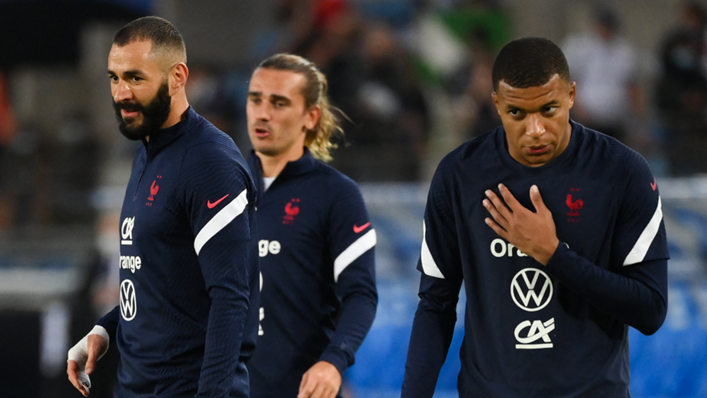 France's forward Karim Benzema, Antoine Griezmann and Kylian Mbappe warm up prior to the FIFA World Cup Qatar 2022 qualification Group D football match between France and Bosnia-Herzegovina