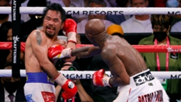Yordenis Ugas (right) throws a right hand at Manny Pacquiao