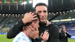 Lionel Scaloni (r) embraces Lionel Messi after the Bolivia win