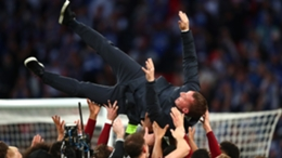Leicester's players celebrate with Brendan Rodgers