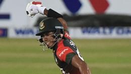 Afif Hossain celebrates after securing victory for Bangladesh over Australia.