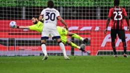 Gianluigi Donnarumma makes a save against Cagliari
