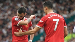 Bruno Fernandes (L) consoled by Manchester United team-mate Cristiano Ronaldo (R) following his penalty miss