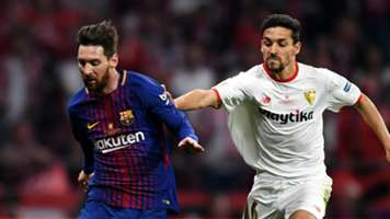 Lionel Messi and Jesus Navas - cropped