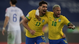 Lucas Paqueta (L) celebrates with Brazil team-mate Neymar (R)