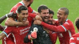 Alisson celebrates his winner for Liverpool
