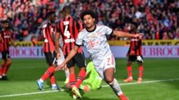 Serge Gnabry celebrates scoring against Bayer Leverkusen