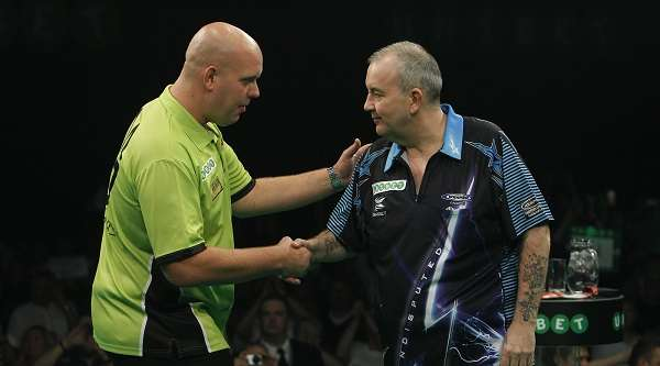 [Image: michael-van-gerwen-phil-taylor-lawrence-...ropto=left]