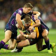 590. Josh McGuire of the Broncos is tackled by Ryan Hoffman  of the Storm