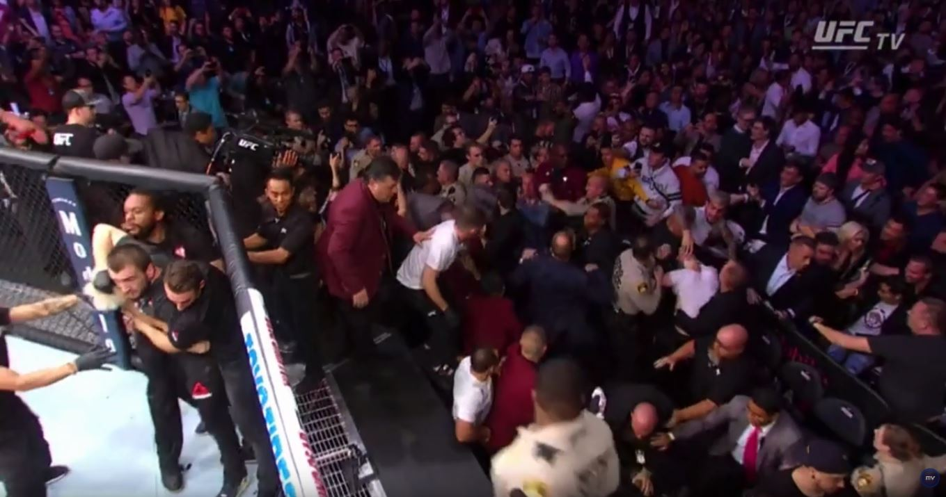 UFC 229: All hell breaks loose after Khabib jumps cage after submitting Conor McGregor ...