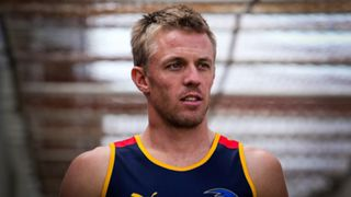 Nathan van Berlo walks out before taking part in an Adelaide Crows AFL training session. Mar 21 2013