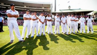 Captain Alastair Cook (L) and the England players