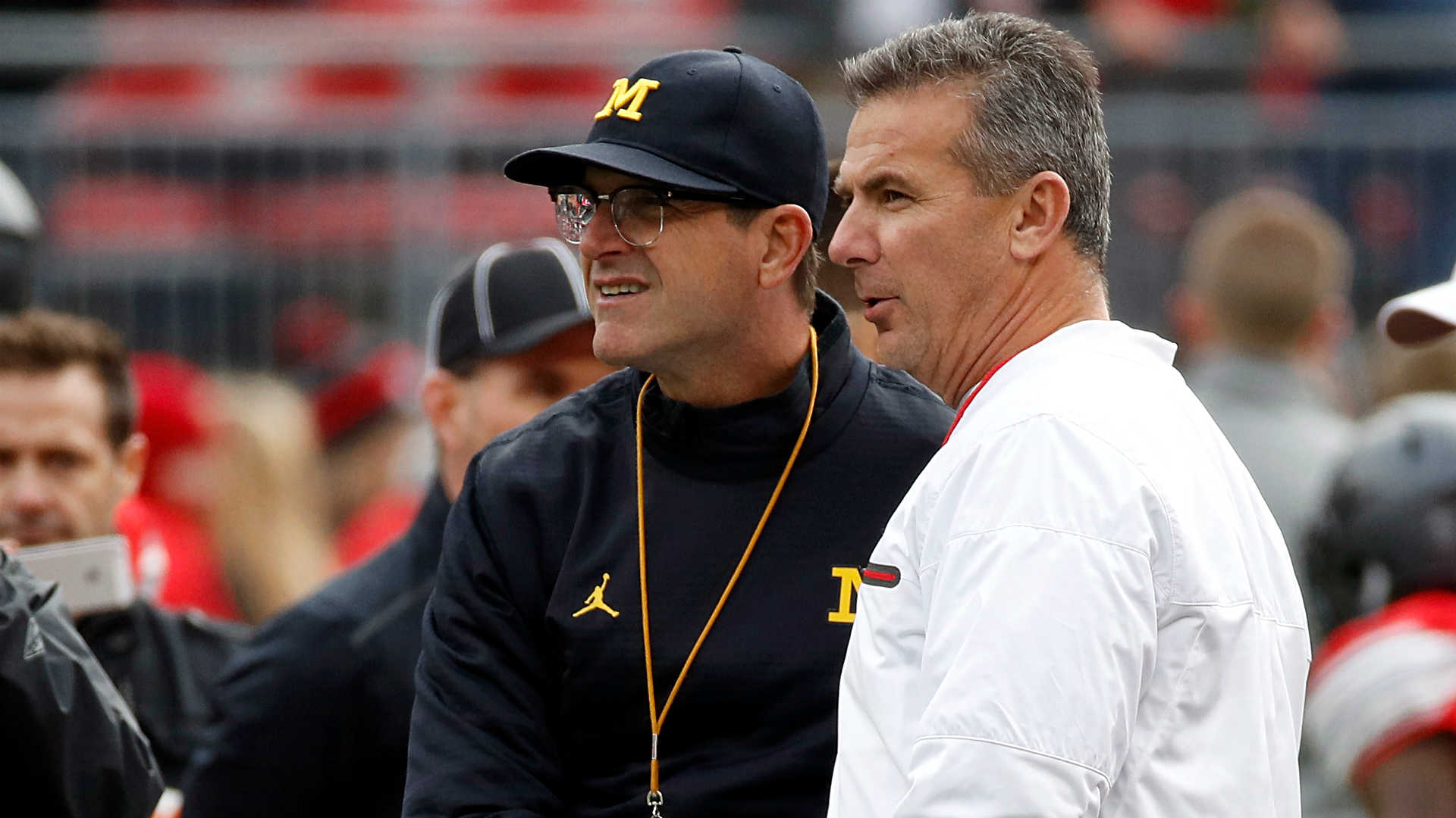 Jim Harbaugh takes shot at Urban Meyer: 'Controversy follows everywhere he's been'