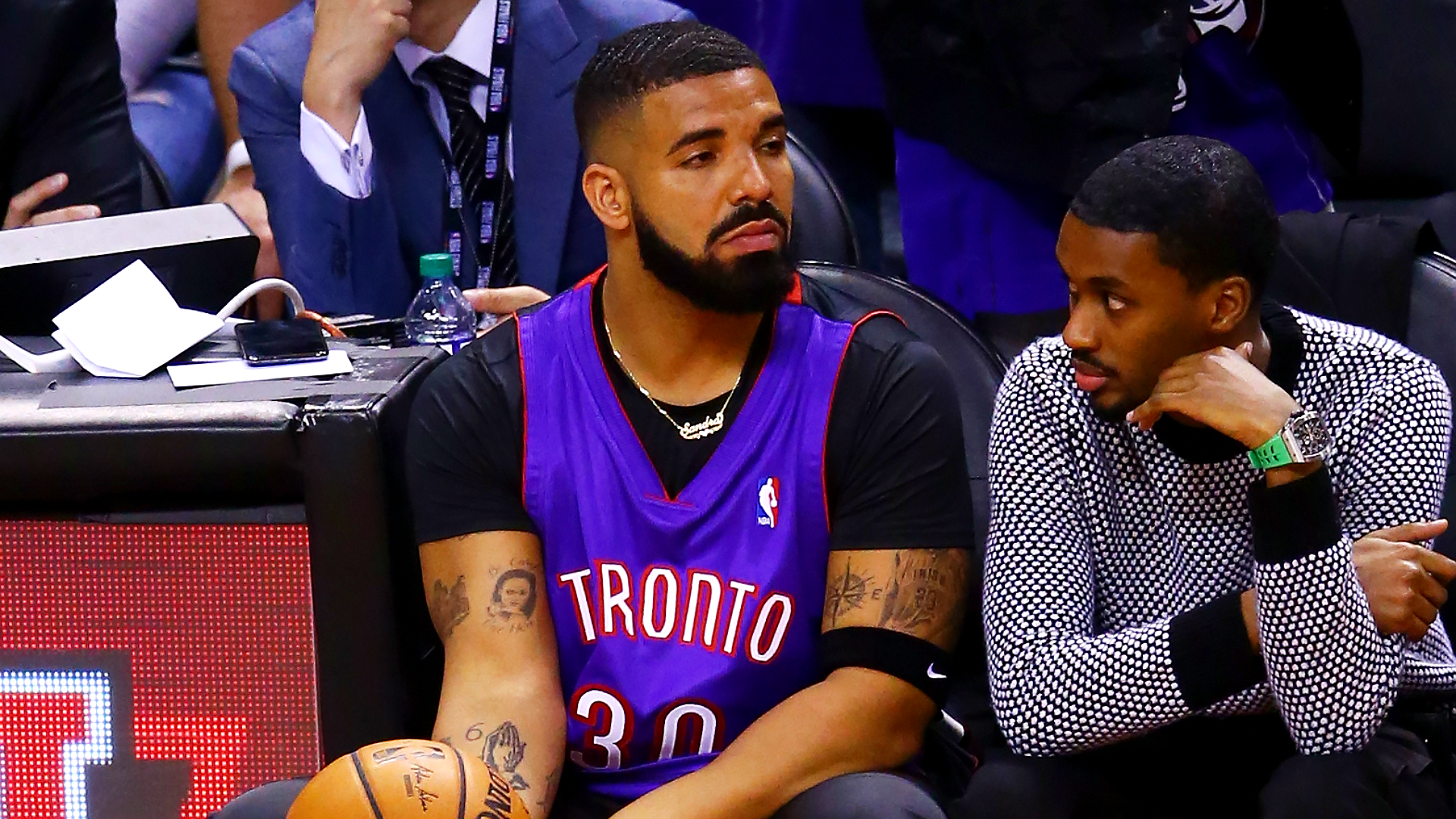 Drake covers up Warriors tattoos as he roots for the Raptors in the NBA Finals