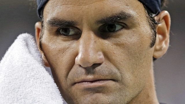 Federer, Wozniacki in prime time after long day's night at