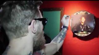 Conor-McGregor-darts-120815-YouTube-FTR