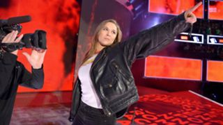 Ronda Rousey into WWE as a Raw Superstar